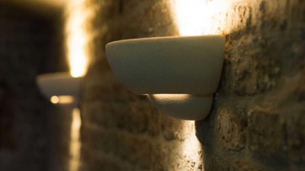 Detail photo of an indirect lighting at the brick wall in the interior area
