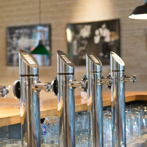 Detail view taps in the taproom of the restaurant